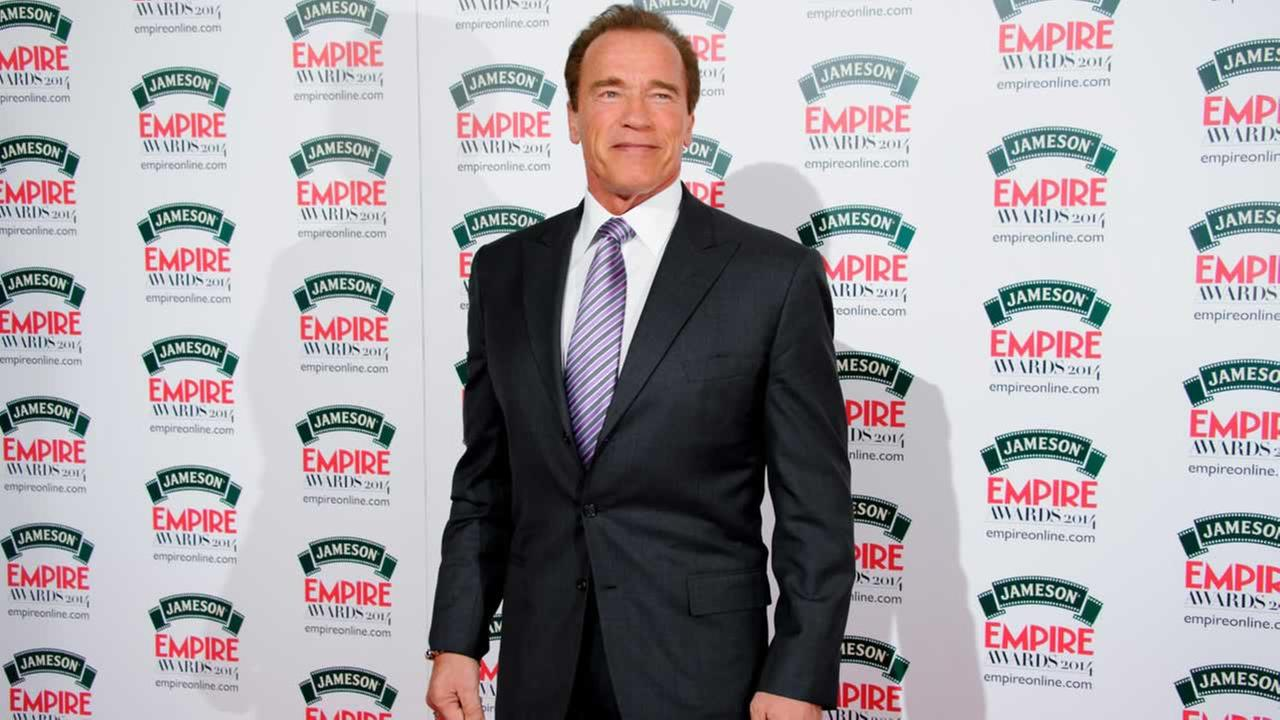 Arnold Schwarzenegger arrives for the Empire Awards at a central London venue, London, Sunday, Mar. 30, 2014.