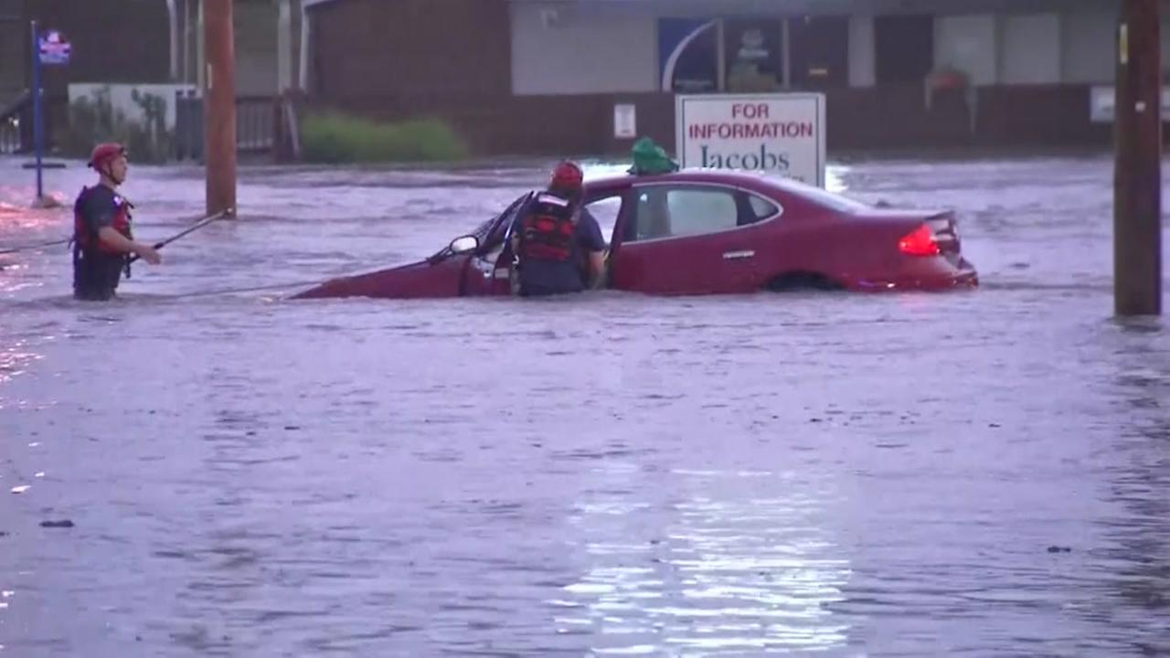 A car is overwhelmed by flood waters in San Jose, Calif. in Feb. 2017.