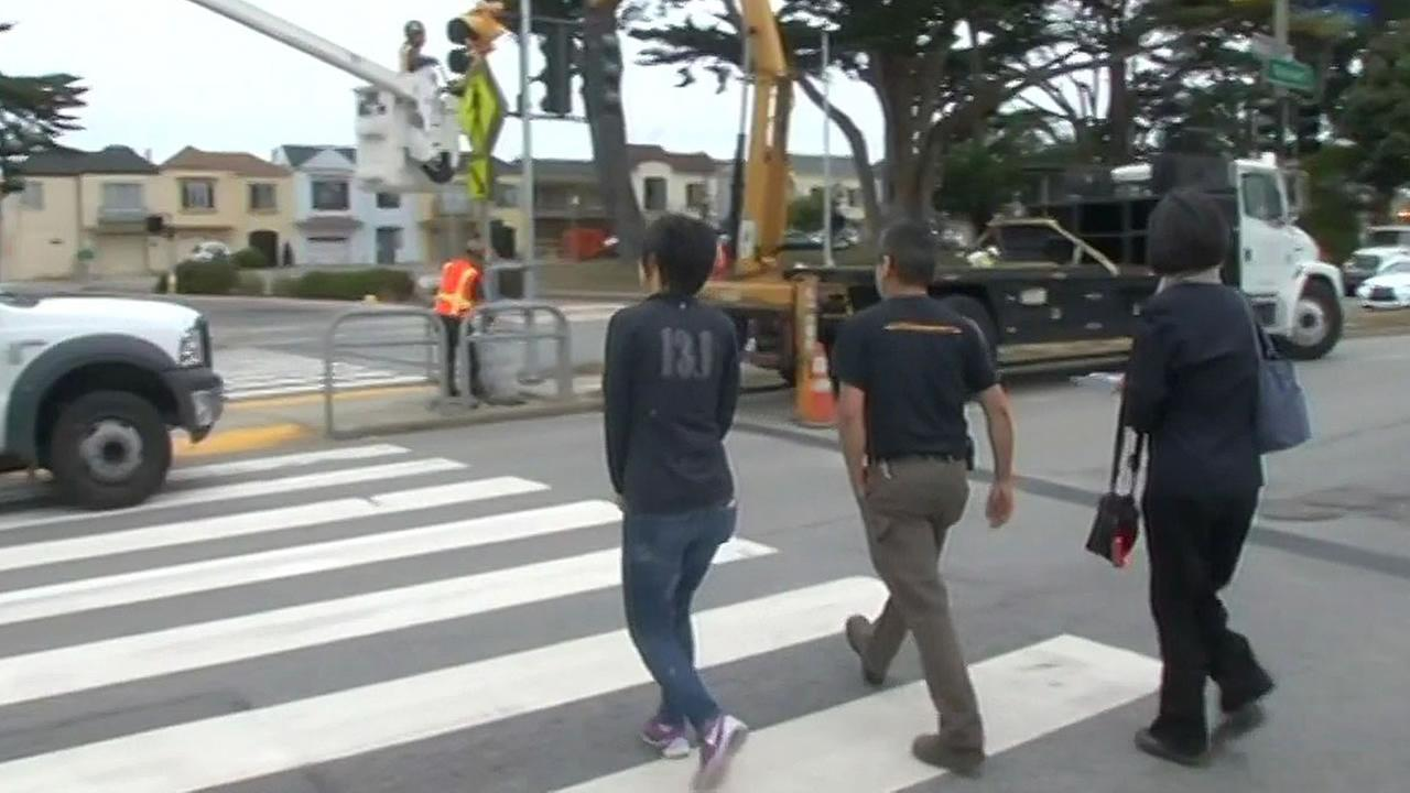 People crossing the new crosswalk at Sunset Boulevard