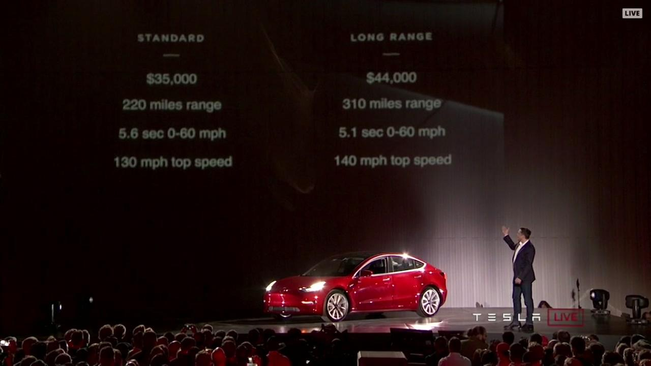 Elon Musk unveils Tesla Model 3 cars in Fremont, Calif. on July 28, 2017.