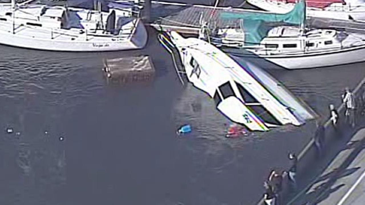 Several boats in Santa Cruz Harbor got loose and are crashed around in the waves during Fridays tsunami warning.