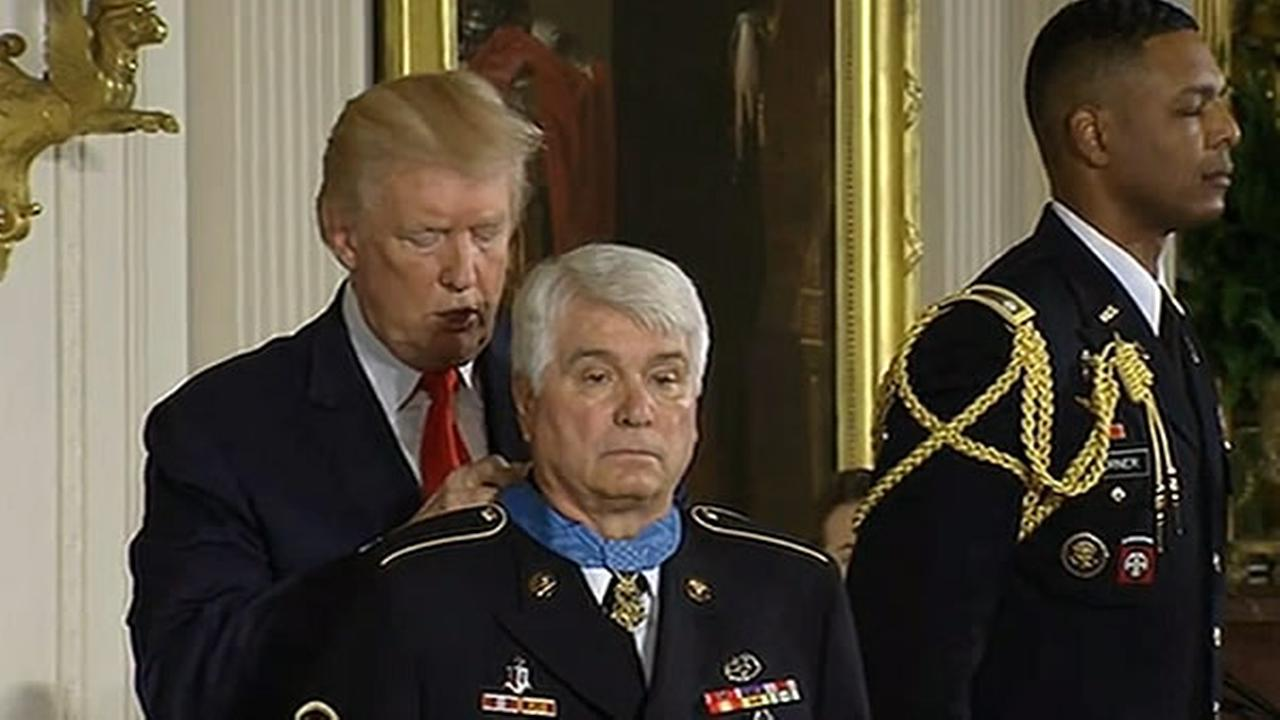 Former Army medic James McCloughan is seen receiving the Medal of Honor from President. Trump on Monday, July 31, 2017.