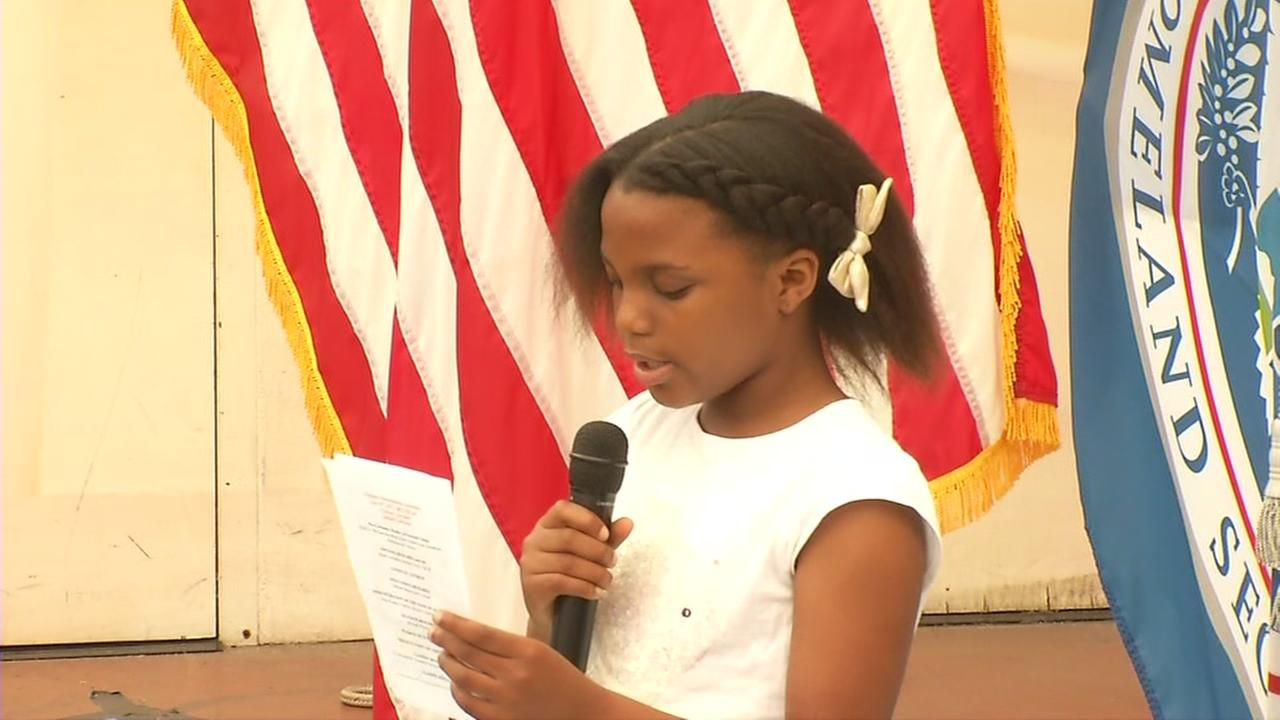 Nkem Enenta, 9, is seen reciting the Pledge of Allegiance in Oakland, Calif. on Monday, July 31, 2017.