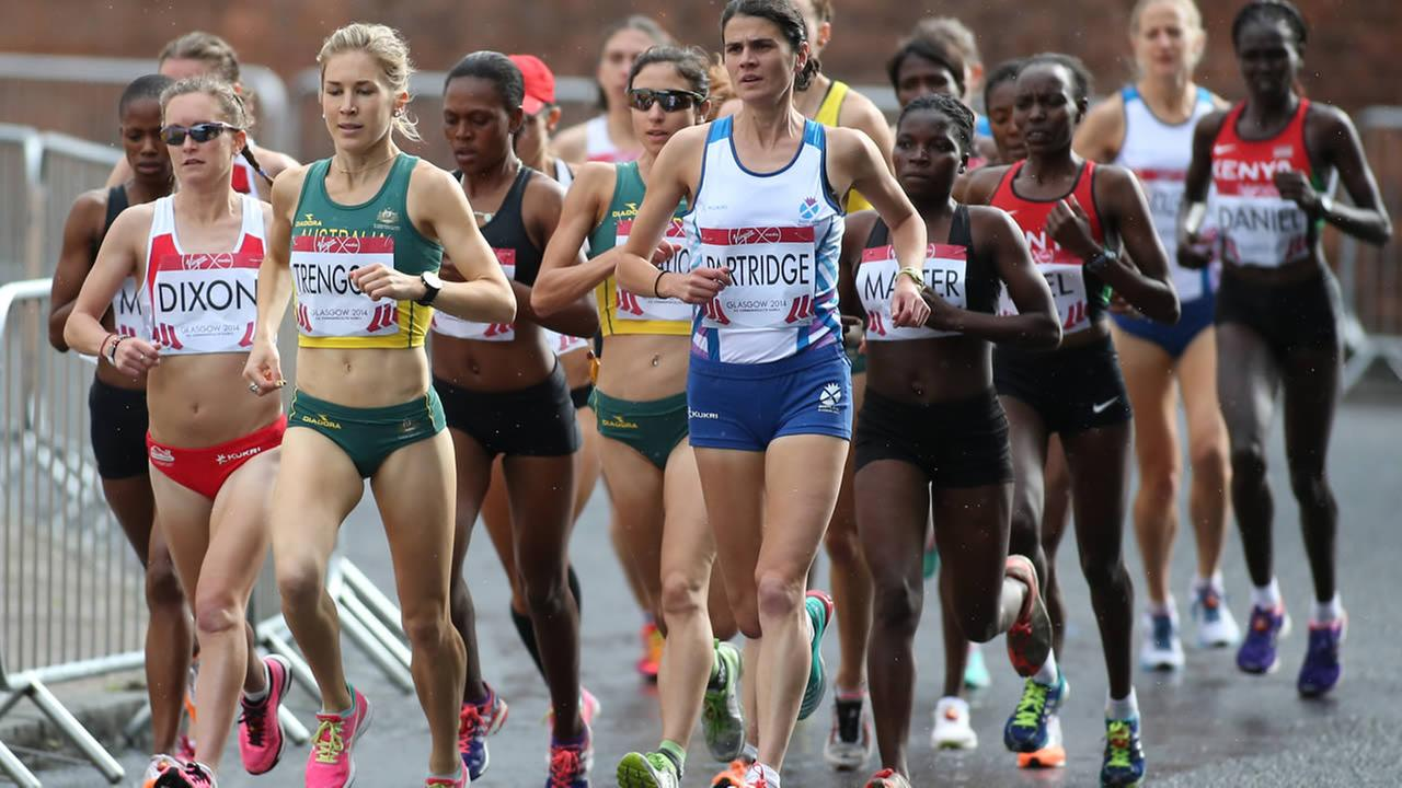 Athletes compete in the Womens Marathon race in the Commonwealth Games Glasgow 2014, Scotland, Sunday July 27, 2014. (AP Photo/Peter Morrison)