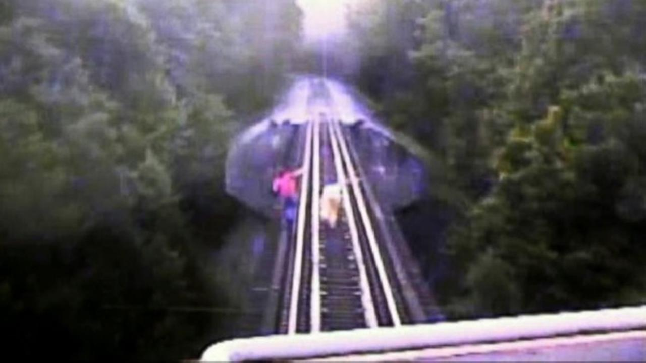 Two women trespassing nearly killed by freight train