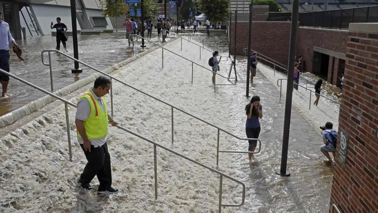 A broken 30-inch water main under nearby Sunset Boulevard inundated a large area of the UCLA campus in the Westwood section of Los Angeles, July 29, 2014. (AP Photo/Mike Meadows)