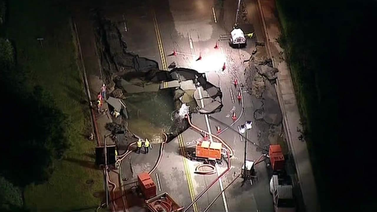 A broken 30-inch water main under nearby Sunset Boulevard flooded a large area of the UCLA campus and opened up a massive 15-foot sinkhole.