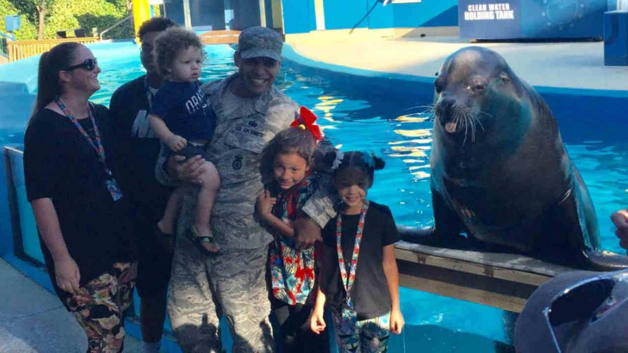 Technical Sergeant Jacob Thomas is seen with his children at Six Flags Discovery Kingdom in Vallejo, Calif. on Sunday, August 6, 2017.