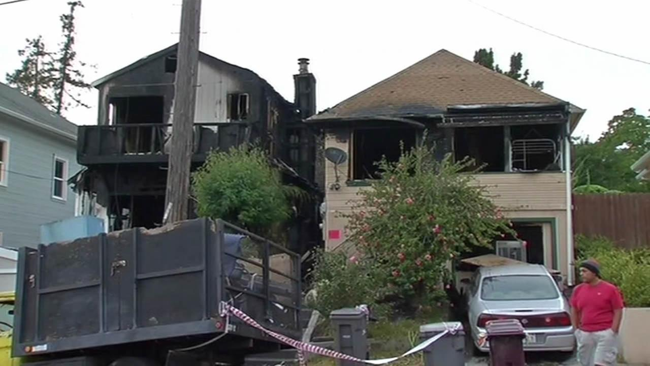 Homes damaged in Oakland fire.