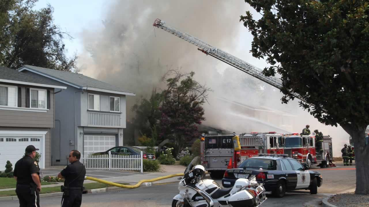 Firefighters this afternoon knocked down a five-alarm fire that destroyed one home and damaged another in San Jose on Wednesday. <span class=meta>(Photo by Michael Demaree)</span>
