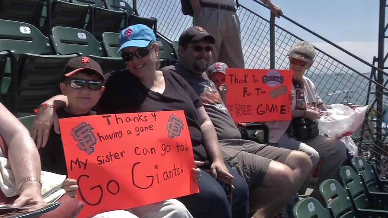Fans enjoy a San Francisco Giants game in the peanut-free section.