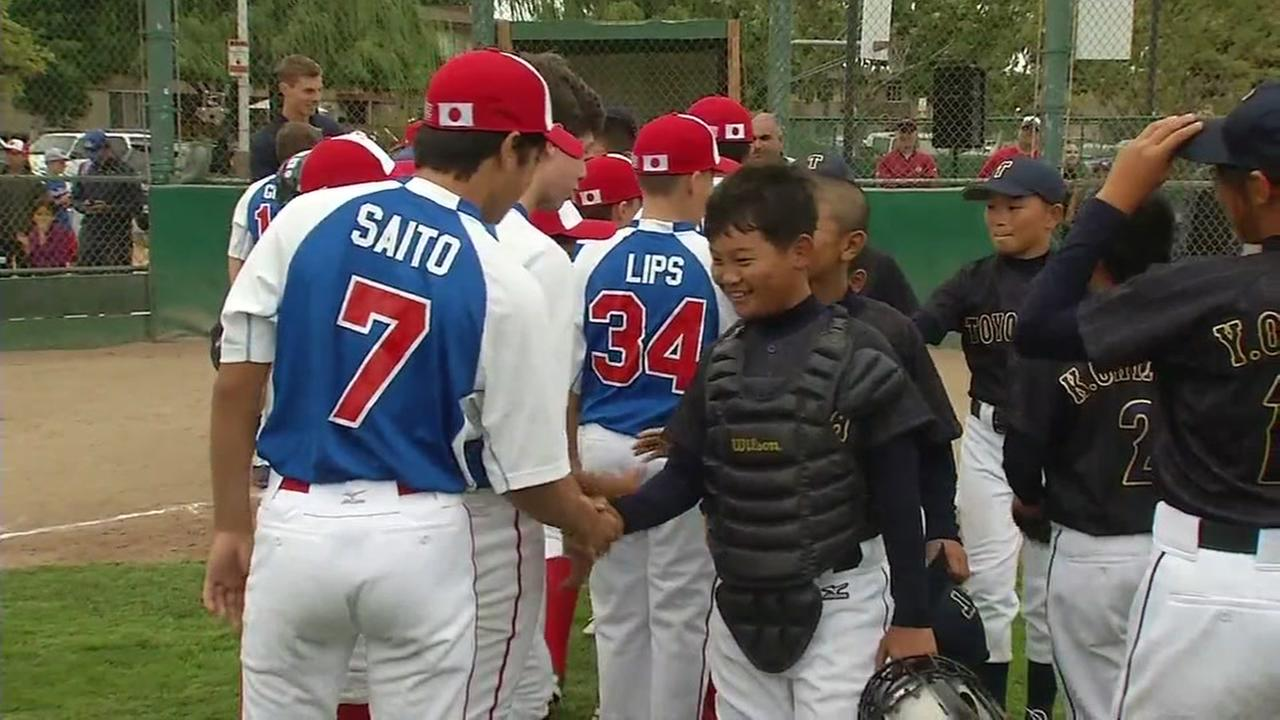 Players from San Mateo shake hands with their counterparts from Japan on Wed., Aug 9, 2107.