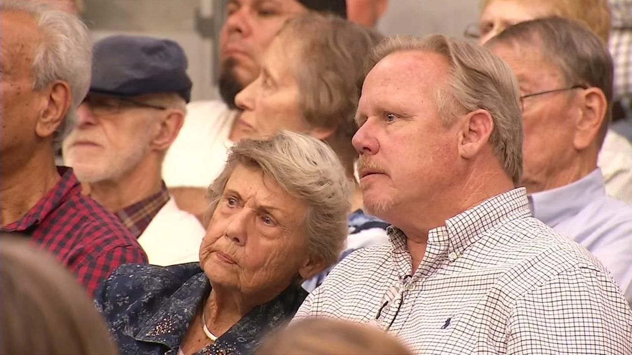 A couple looks concerned at a town hall meeting in Concord, Calif. on Wed., Aug 9, 2017.