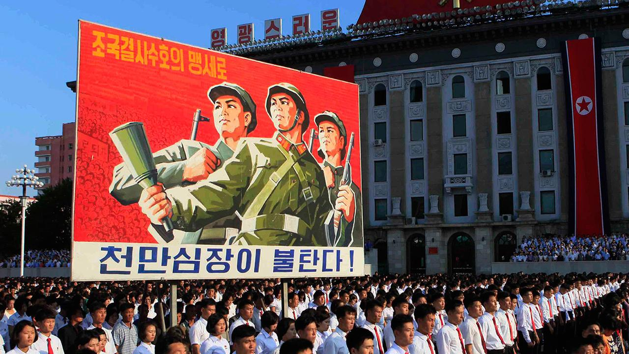 Tens of thousands of North Koreans gathered for a rally at Kim Il Sung Square carrying placards and propaganda slogans on Wednesday Aug. 9, 2017.