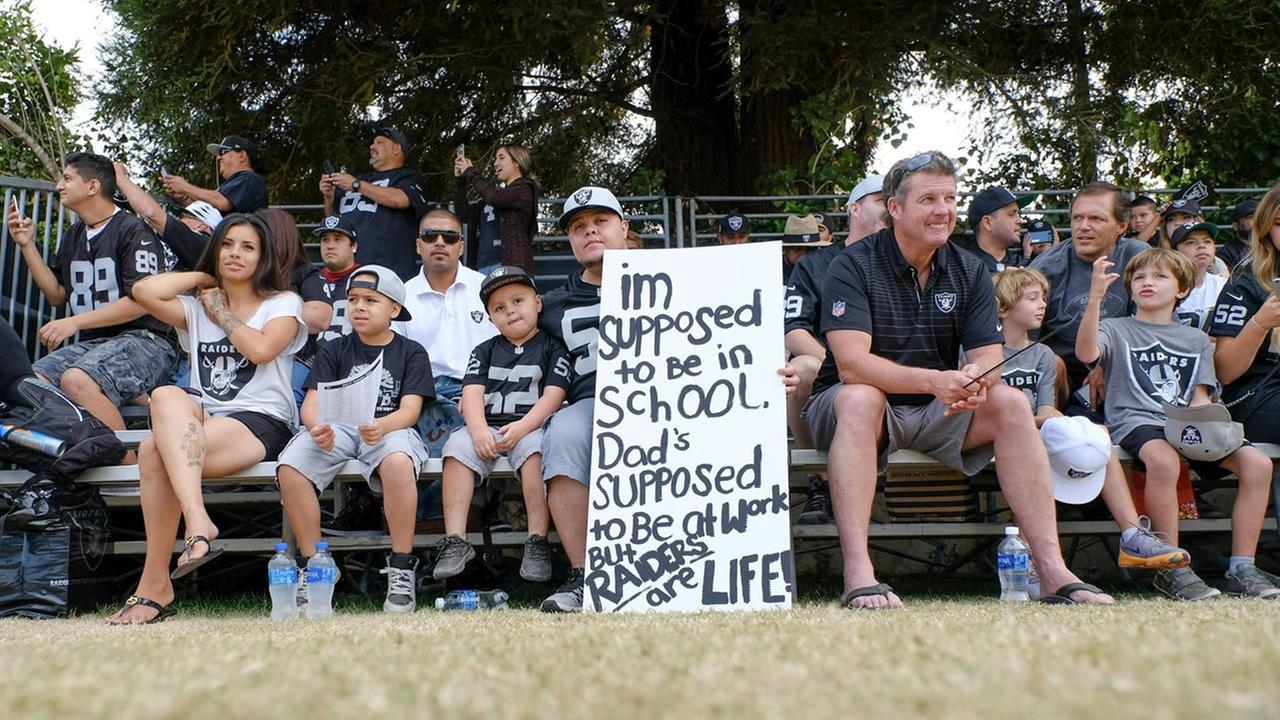 Oakland Raiders fans watch training camp practices in Napa, Calif. on Thurs., Aug. 10, 2017.