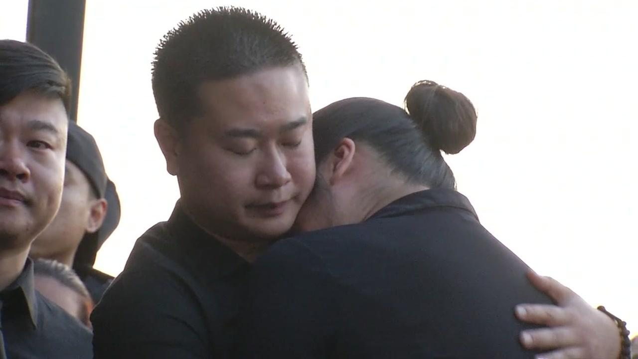 Mourners hug during a vigil on Friday, Aug. 11, 2017 for Charlie Ly, who was killed in San Jose.