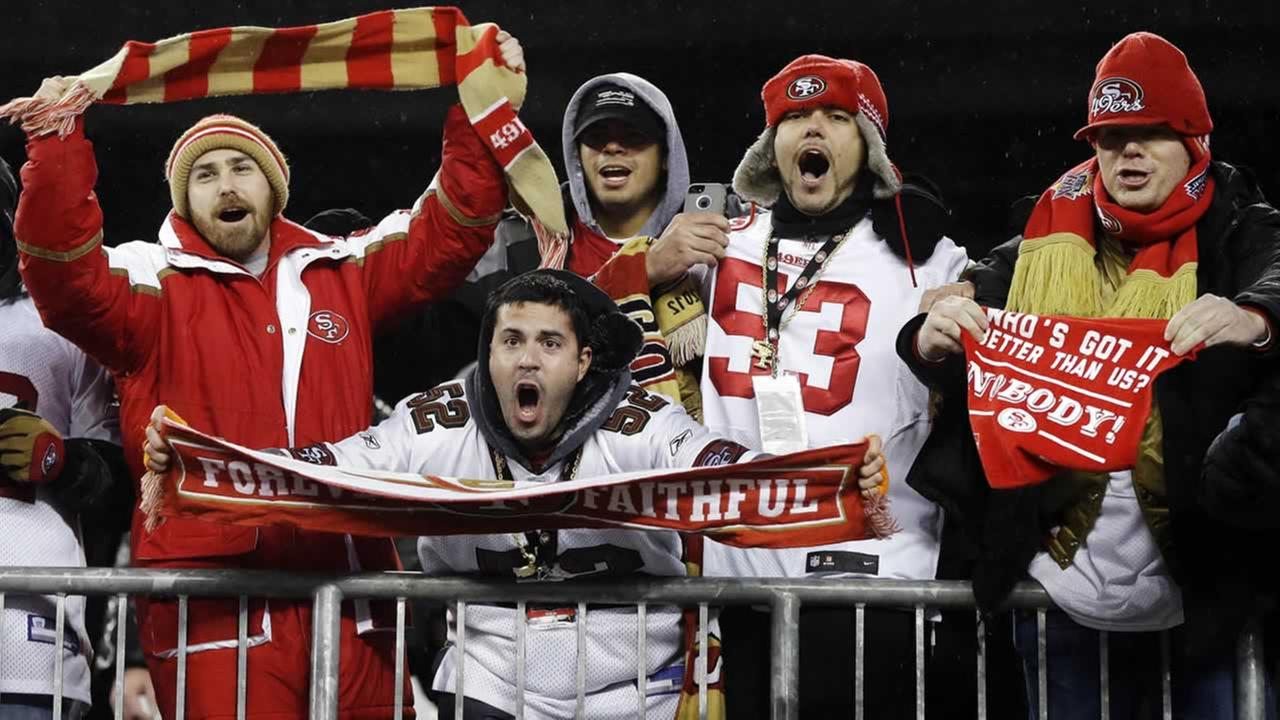 San Francisco 49ers fans celebrate their teams 41-34 win over the New England Patriots in an NFL football game in Foxborough, Mass., Dec. 17, 2012. (AP Photo/Elise Amendola)