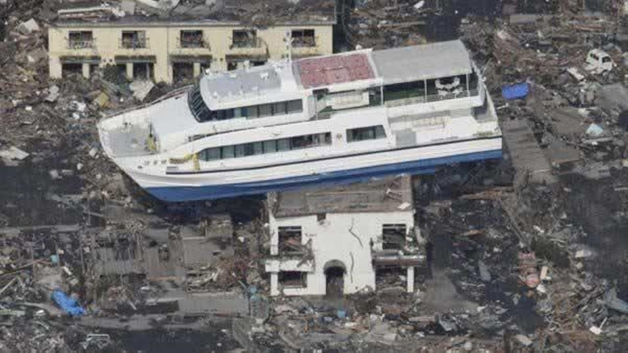 A ferry stranded on a building is seen in Otsuchi, Iwate Prefecture, northern Japan, Sunday, March 13, 2011, two days after a powerful earthquake-triggered tsunami hit the countrys east coast. (AP Photo/The Yomiuri Shimbun) AP Photo/The Yomiuri Shimbun