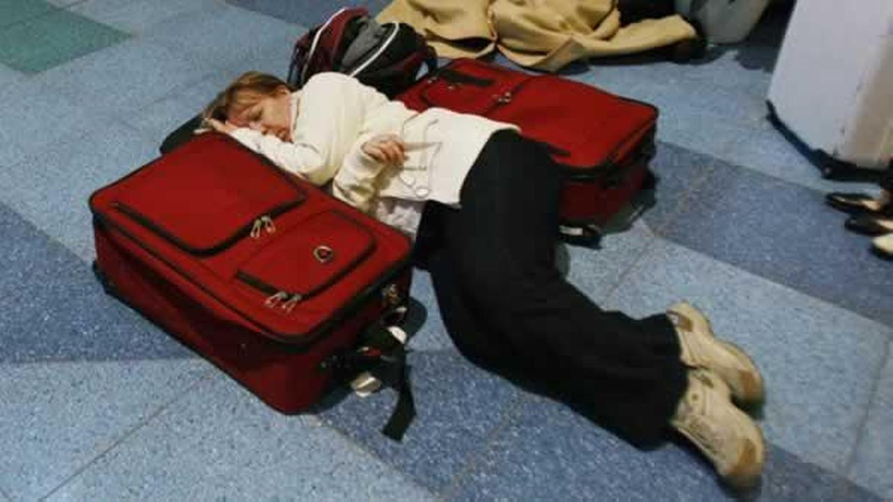 Travelers rest on the floor stranded at the Haneda international airport in Tokyo after a massive earthquake Friday, March 11, 2011. The ferocious tsunami spawned by one of the largest earthquakes ever recorded slammed Japans eastern coasts. (AP Photo/Wally Santana) AP Photo/Wally Santana