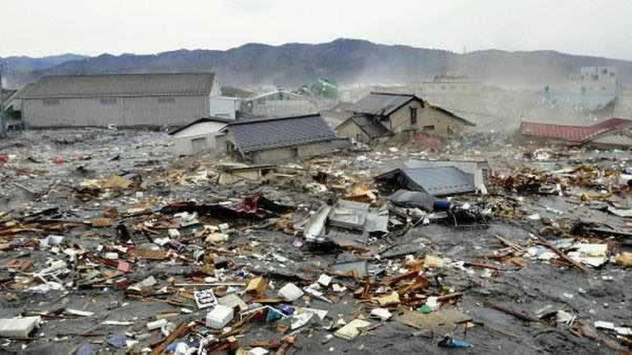Houses, cars and other debris are washed away by tsunami tidal waves in Kesennuma in Miyagi Prefecture, northern Japan, after strong earthquakes hit the area Friday, March 11, 2011. AP Photo/Keichi Nakane, The Yomiuri Shimbun
