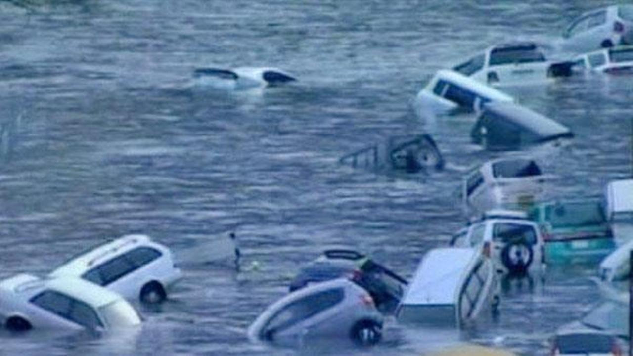 TV footage shows cars being washed away after a tsunami hits following the massive earthquake in Japan on Friday. Photos courtesy NHK World