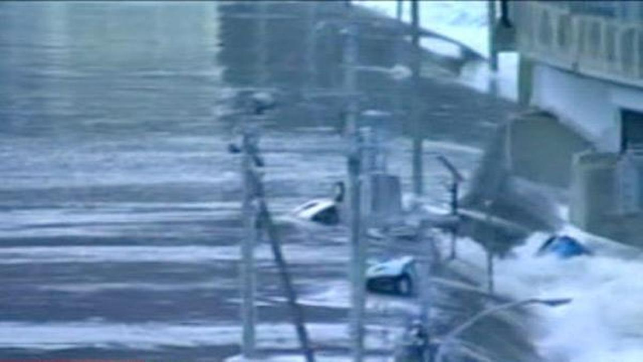 TV footage shows cars being washed away after a tsunami hits following the massive earthquake in Japan on Friday.Photos courtesy NHK World