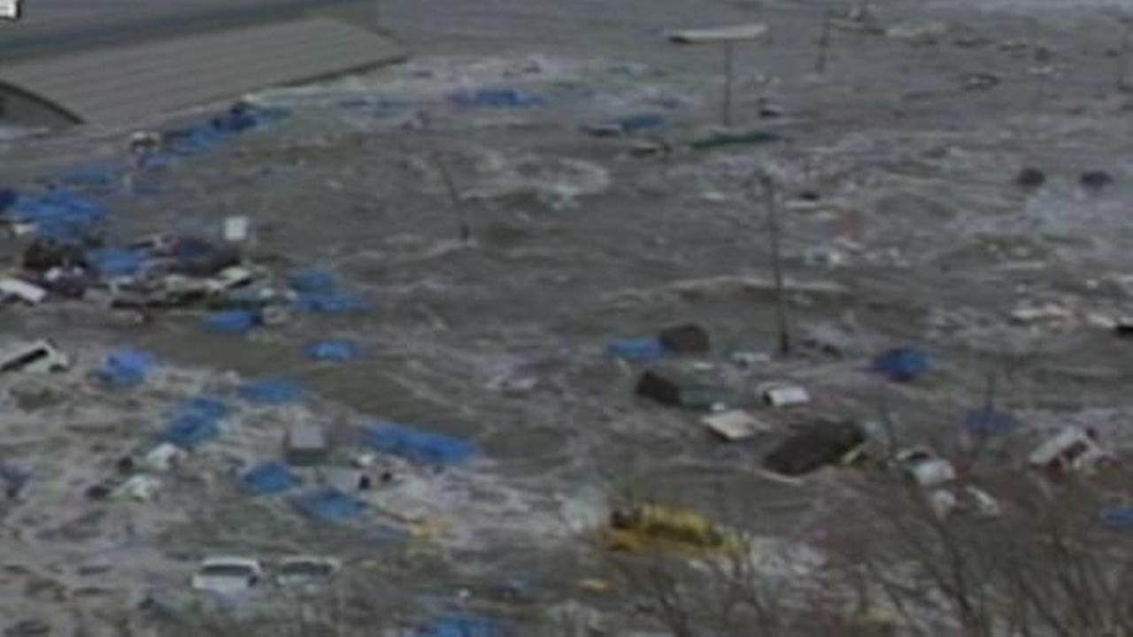 Water filled with debris could be seen after a tsunami hit Japan following a massive earthquake.