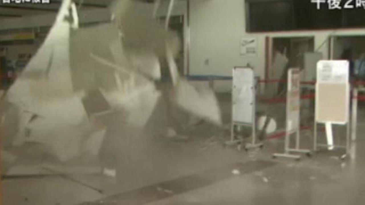A ceiling tile comes crashing down in Japan during a massive earthquake.