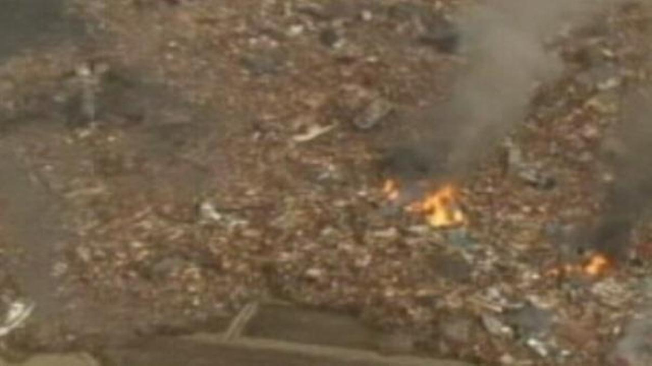 Debris caught by a tsunami wave in Japan catches fire.