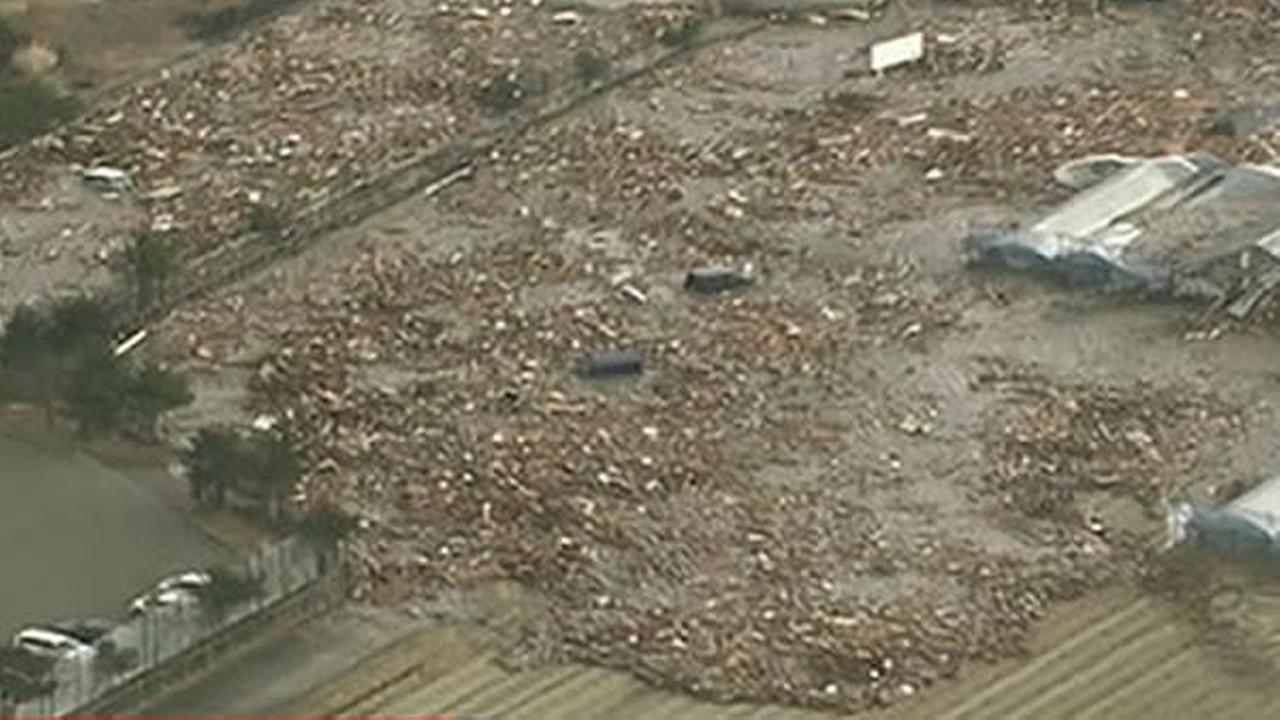 The tsunami rammed directly into a breakwater in Kesennuma city in Miyagi prefecture, according to footage on public broadcaster NHK. (Photo courtesy NHK World)Photo courtesy NHK World