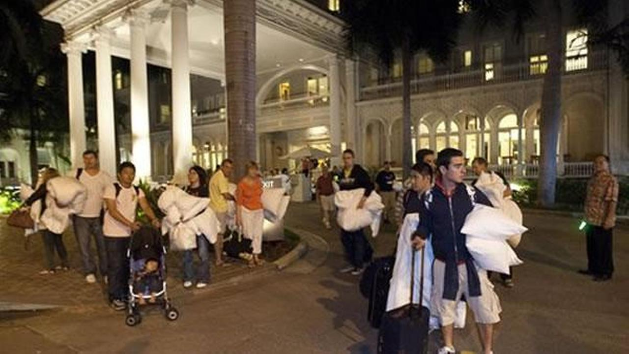 Hotel guests from the Moana Surfrider evacuate early Friday, March 11, 2011 in Honolulu. The state of Hawaii is under a tsunami warning due to a large 8.9 earthquake which struck off Japan. The earthquake is believed to have generated a tsunami wave. The Pacific Tsunami Center expects the wave to hit Oahu at 3:21 a.m. Hawaiian Standard Time. (AP Photo/Eugene Tanner)AP Photo/Eugene Tanner