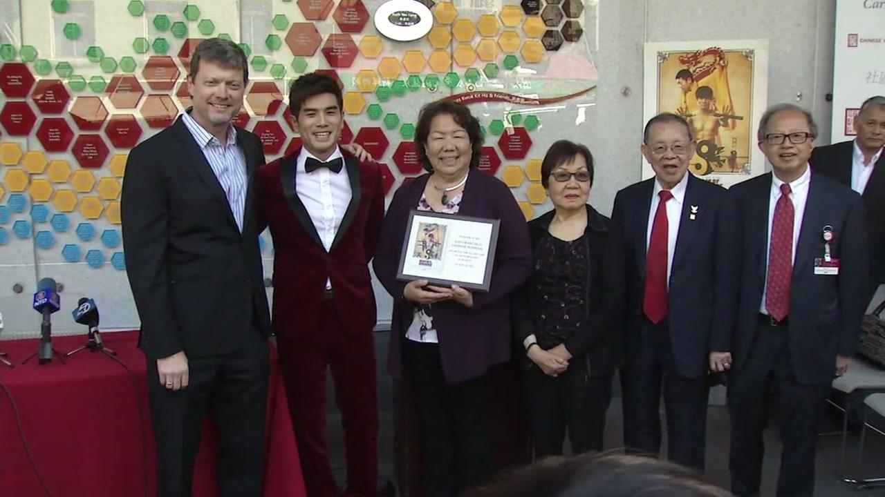 Director George Nolfi and actor Philip Ng present a plaque to San Franciscos Chinese Hospital, where Bruce Lee was born, on Wednesday, Aug. 16, 2017.