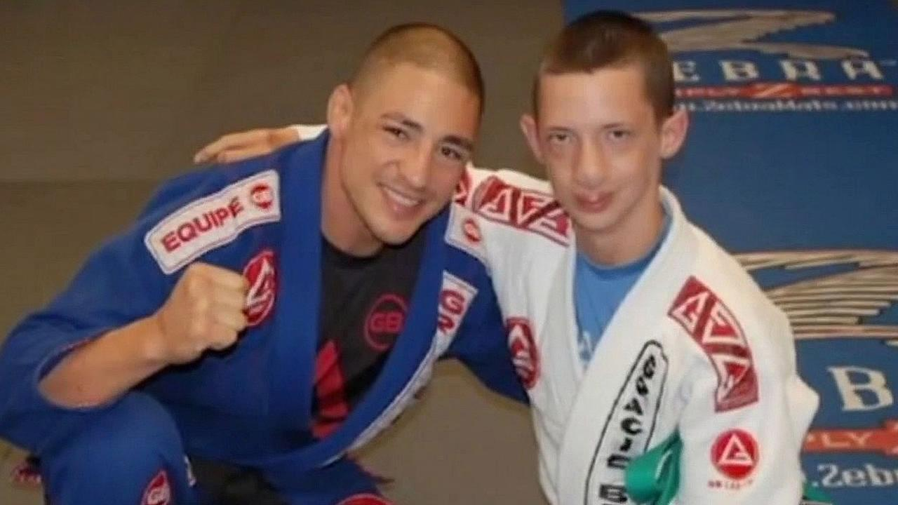 Teenager Branden Hussey, pictured on the right, poses in his Jiu Jitsu uniform.