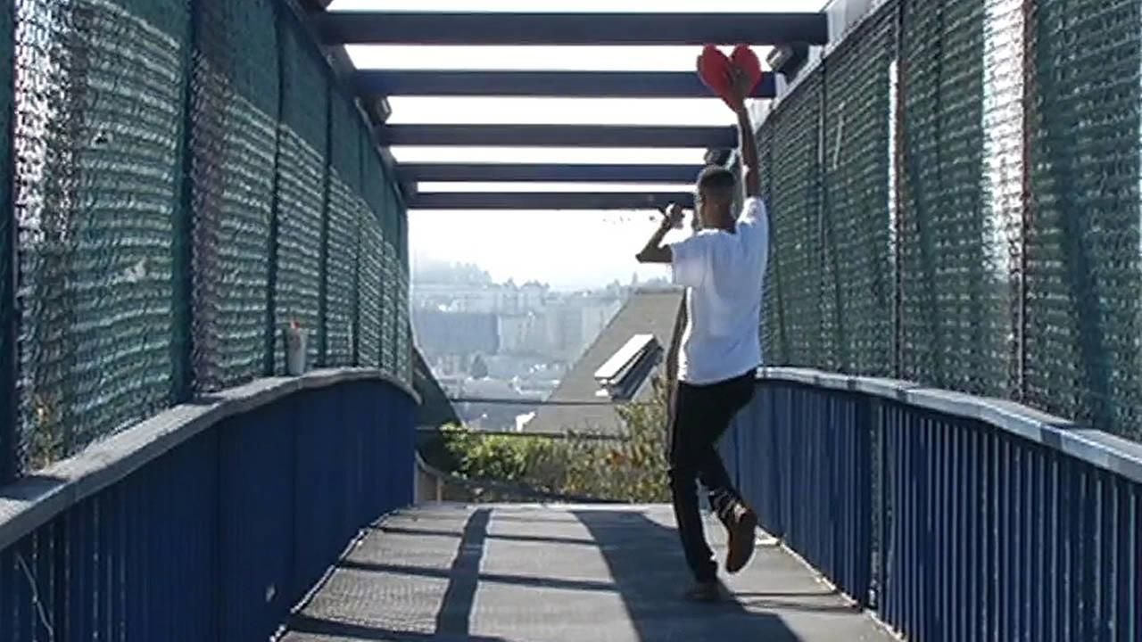 Javonne Hatfield dances with his heart on a Highway 101 overpass