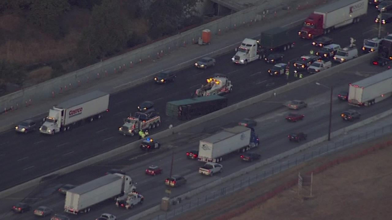 Big-rig flips over center divider on Interstate-580 in Livermore