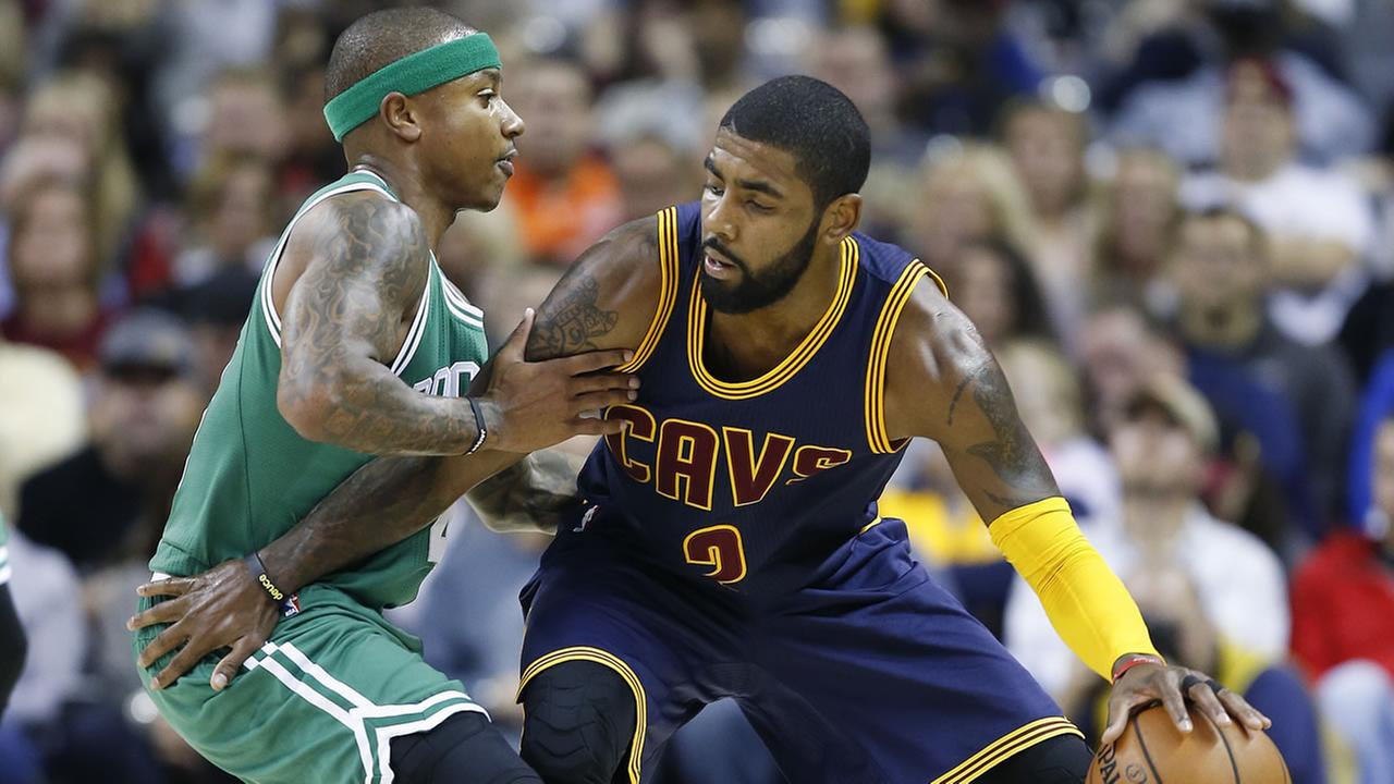 In this Nov. 3, 2016, photo, Cavaliers Kyrie Irving, right, looks to drive against Celtics Isaiah Thomas during the first half of an NBA basketball game in Cleveland.