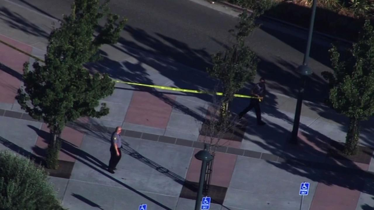 Police put up yellow tape outside the Dublin/Pleasanton BART station while they investigated a suspicious package.