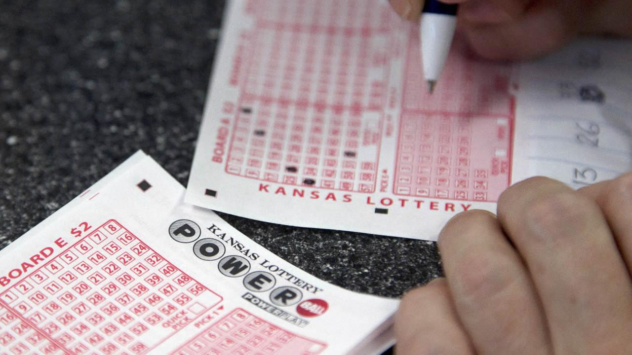 A customer fills out a Powerball form at the Jayhawk Food Mart in Lawrence, Kan., Friday, Nov. 23, 2012. (AP Photo/Orlin Wagner)