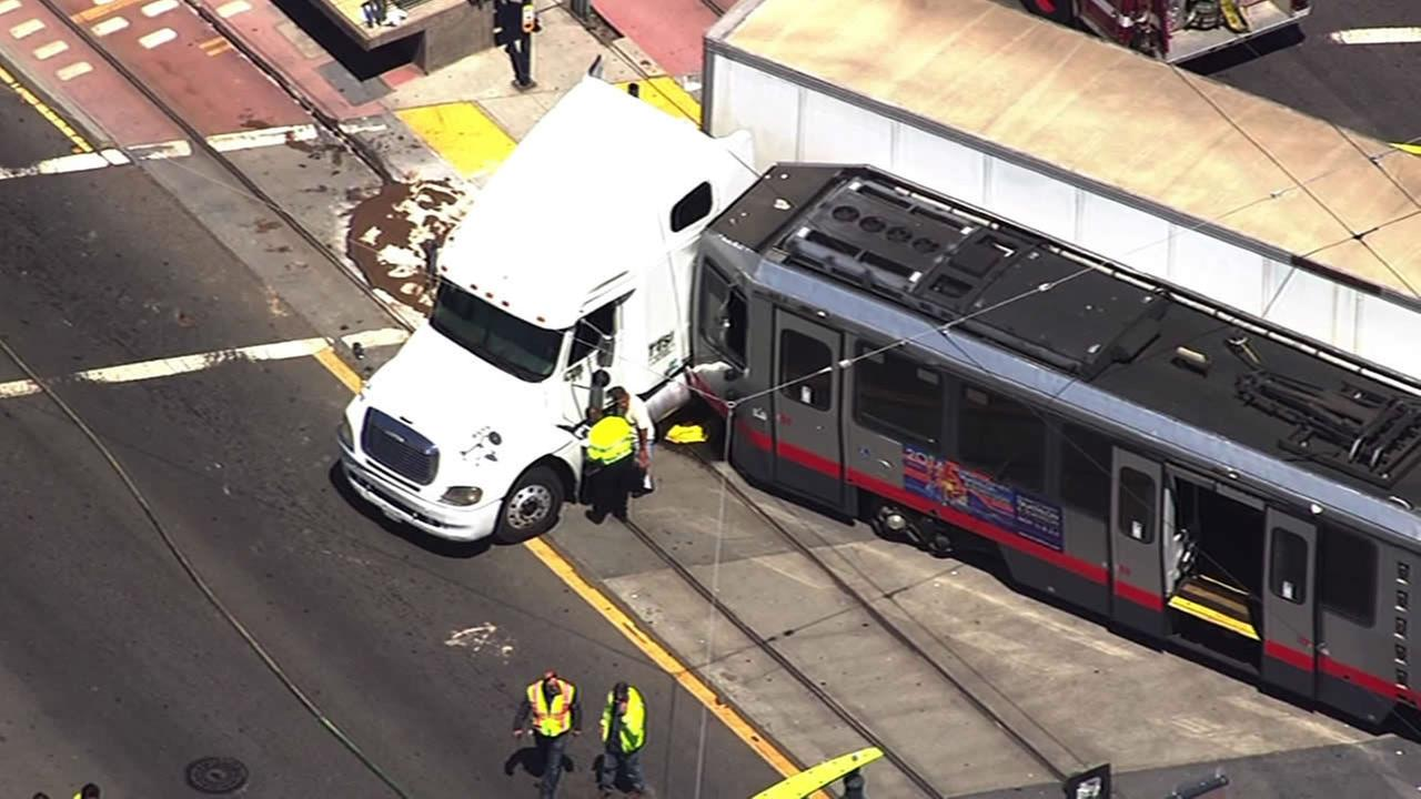 PHOTOS: Big rig collides with MUNI bus in SF