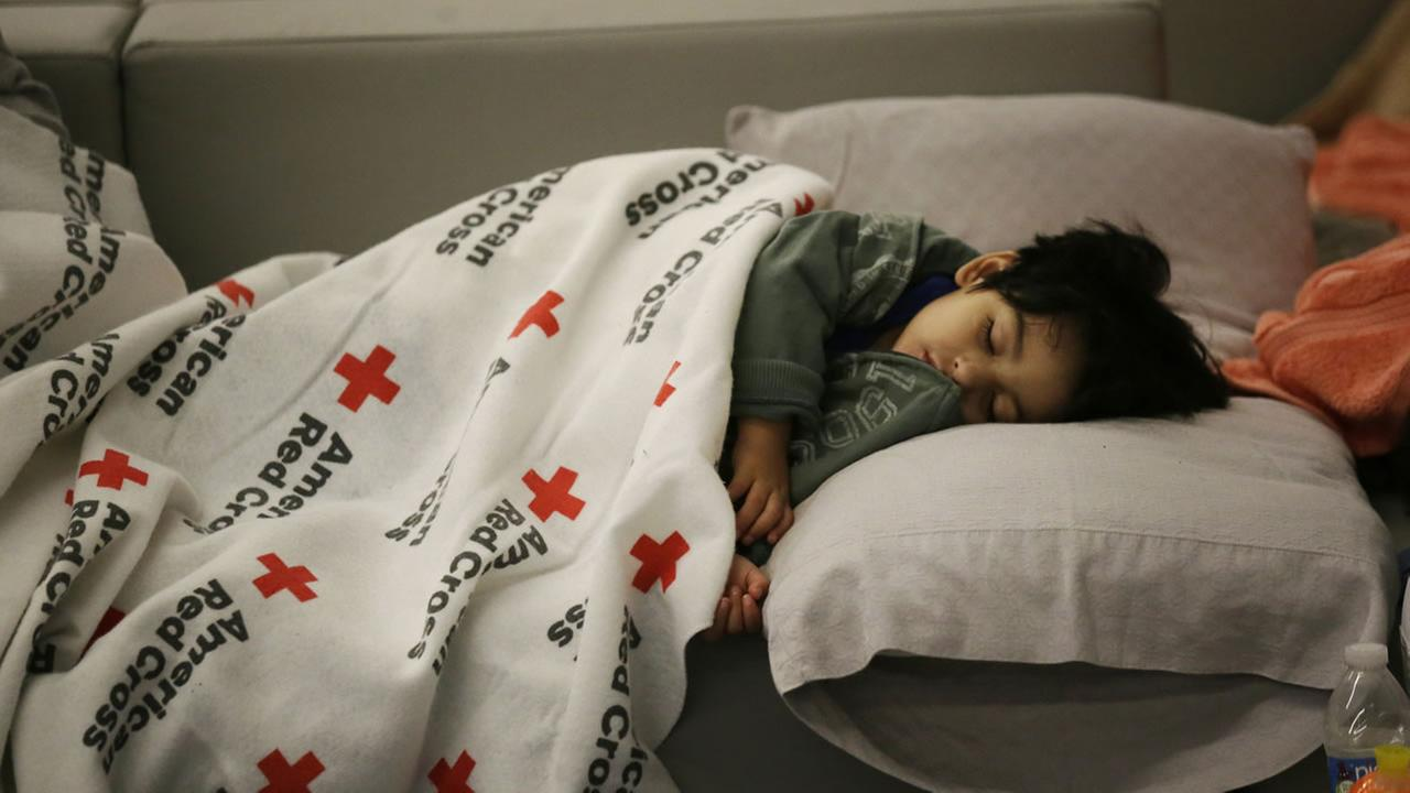 Malachia Medrano, 2, sleeps at the George R. Brown Convention Center that has been set up as a shelter for evacuees escaping the floodwaters from Tropical Storm Harvey in Houston.