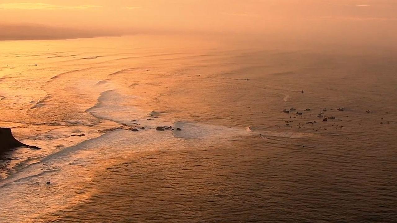 Golden colors of the sunrise as Mavericks begins.