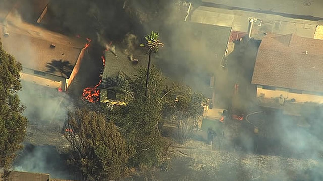 Firefighters are battling a 7-alarm grass fire burning along Marigold Drive near Interstate 80 in Fairfield.