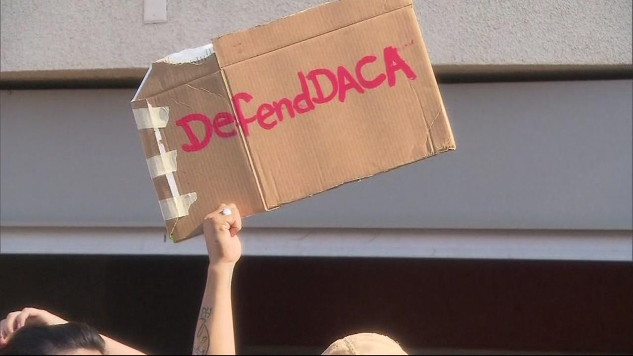 A protester holds up a sign reading, Defend DACA on Monday, Sept. 4, 2017.