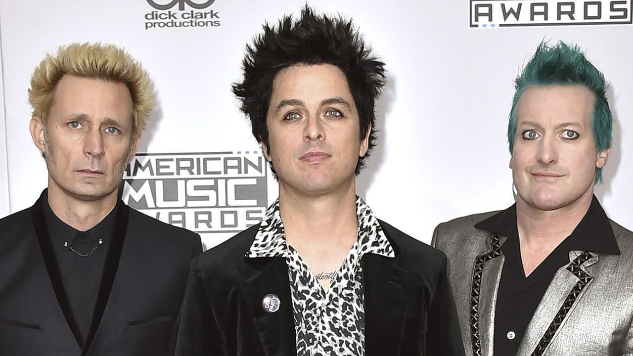 Mike Dirnt, from left, Billie Joe Armstrong, and Tre Cool, of Green Day, arrive at the American Music Awards at the Microsoft Theater on Sunday, Nov. 20, 2016, in Los Angeles. (Photo by Jordan Strauss/Invision/AP)