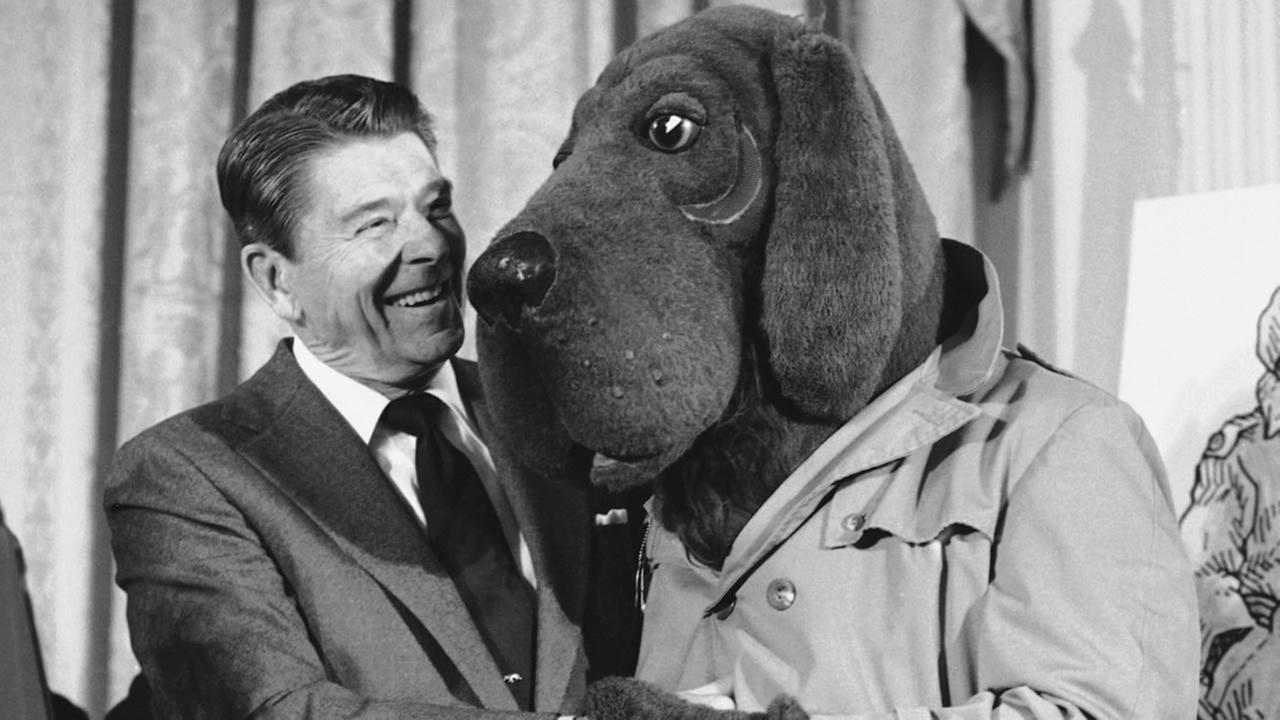 In this Feb. 15, 1984, file photo, President Ronald Reagan meets McGruff the crime dog, during Crime Prevention Week ceremonies at the White House in Washington. (AP Photo/Barry Thumma, File)