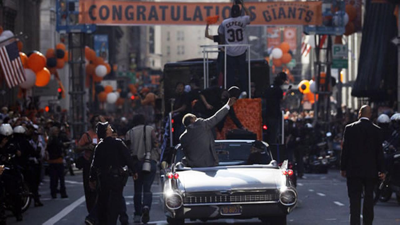 Photos of the San Francisco Giants celebrating their World Series victory with a parade in downtown.