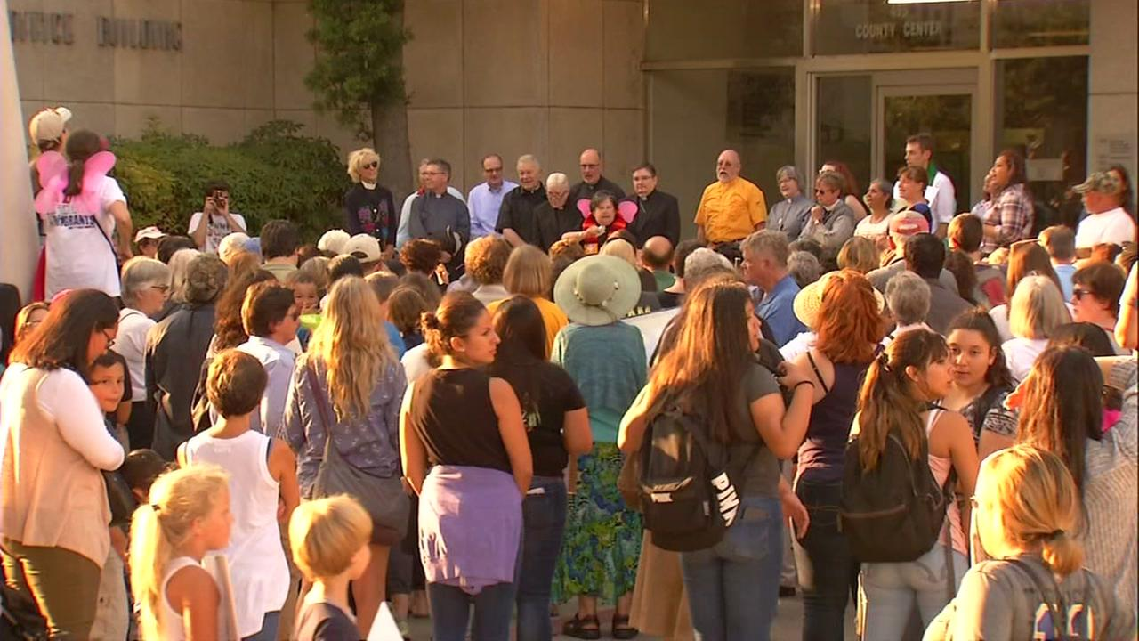 Community members gather in Redwood City, Calif. on Wednesday, Sept. 6, 2017 to pray for undocumented immigrants.