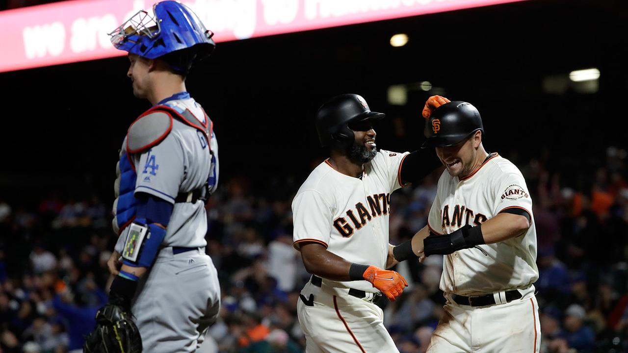 San Francisco Giants Denard Span, center, celebrates his two-run home run with teammate Joe Panik, Monday, Sept. 11, 2017, in San Francisco.