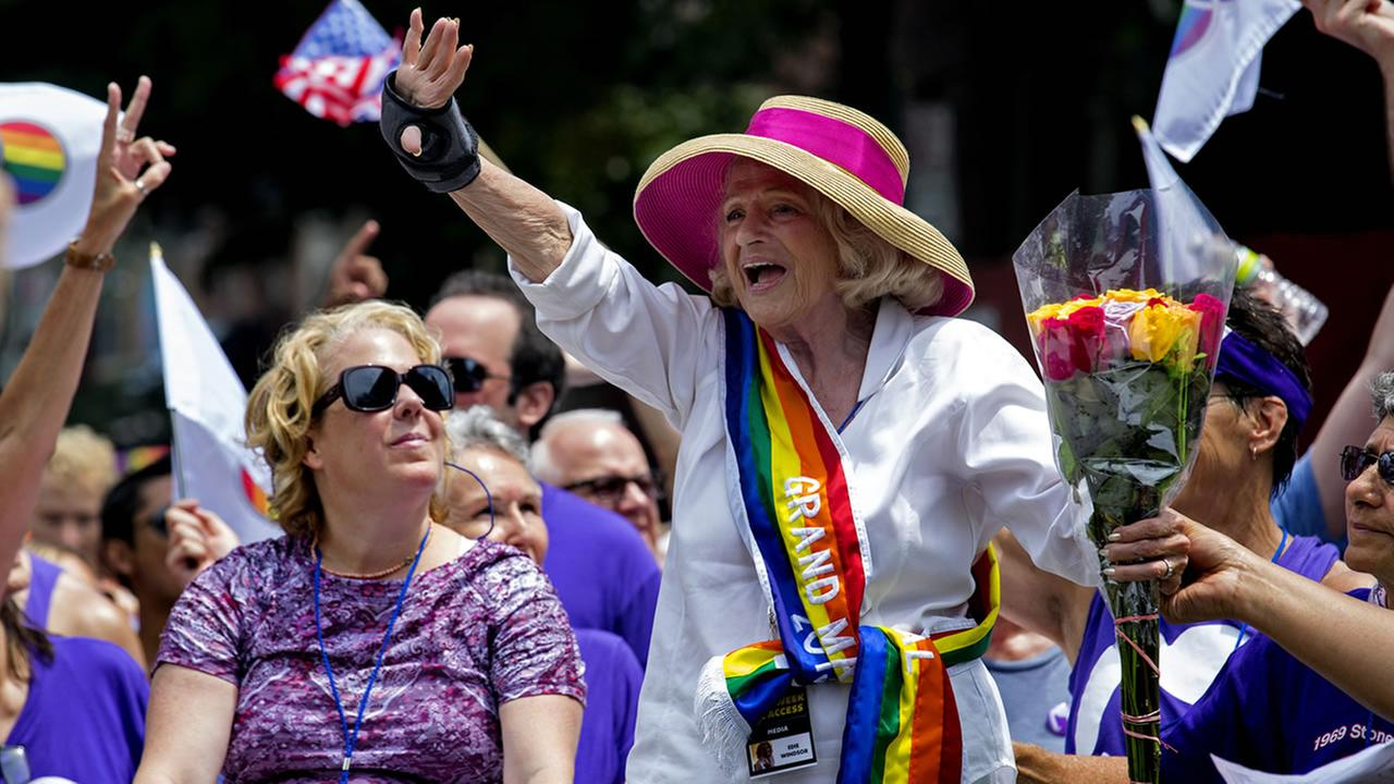 Grand Marshall Edith Windsor smiles as she rides in a convertible during the gay pride march in New York Sunday, June 30, 2013. (AP Photo/Craig Ruttle)