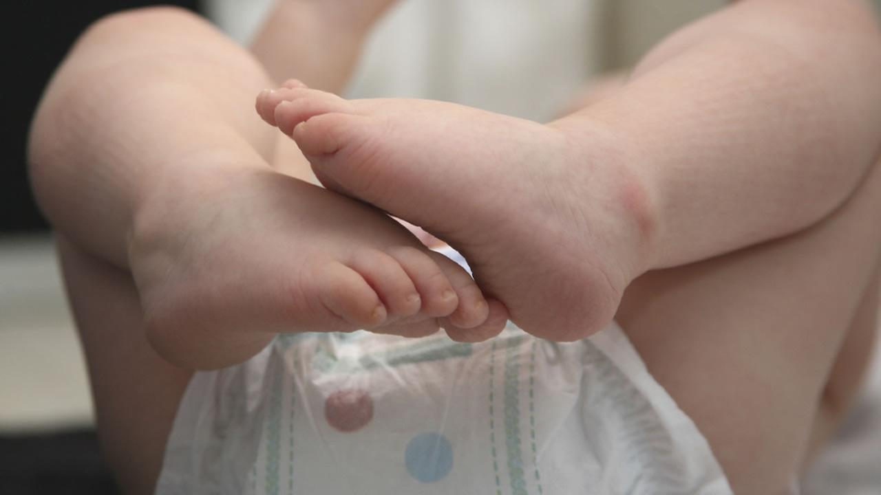 A baby in a diaper.